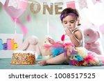 baby girl cake smash | Shutterstock . vector #1008517525