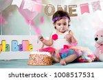 baby girl cake smash | Shutterstock . vector #1008517531