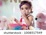 baby girl cake smash | Shutterstock . vector #1008517549