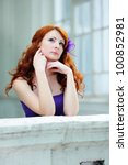 Young beautiful redhead woman portrait standing on balcony. - stock photo