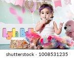baby girl cake smash | Shutterstock . vector #1008531235