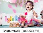 baby girl cake smash | Shutterstock . vector #1008531241
