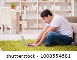 man working on laptop at home... | Shutterstock . vector #1008554581
