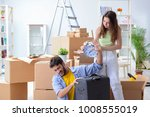 young family unpacking at new... | Shutterstock . vector #1008555019