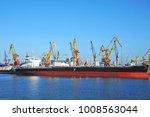 bulk cargo ship under port... | Shutterstock . vector #1008563044