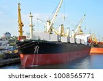 bulk cargo ship under port... | Shutterstock . vector #1008565771