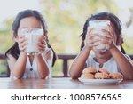 two cute asian little child... | Shutterstock . vector #1008576565