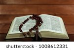 bible and a crucifix on a black ... | Shutterstock . vector #1008612331