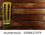 old guitar and wooden backgroun. | Shutterstock . vector #1008617479