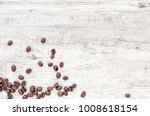 coffee beans on wood background | Shutterstock . vector #1008618154