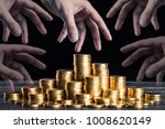 Small photo of A large amount of gold coins with black back