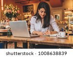 young businesswoman is sitting... | Shutterstock . vector #1008638839
