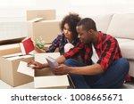 happy african american couple... | Shutterstock . vector #1008665671