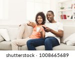 smiling african american couple ... | Shutterstock . vector #1008665689