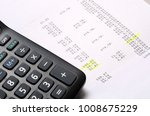 Small photo of Euro Pay slip and calculator, close up for payroll or salary background, french mention Net to pay