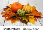 pumpkins and autumn  leaves on... | Shutterstock . vector #1008676264