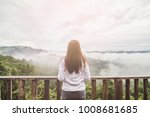 the woman stands alone on the... | Shutterstock . vector #1008681685