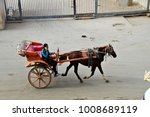 Small photo of CAIRO, EGYPT - 2 JANUARY 2018: A horse-drawn cart on the streets of Cairo. These carts sustain thousands of low-income households & yet numerous municipal officials have sought to ban them. Editorial.