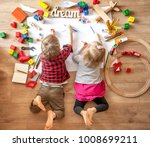 kids drawing on floor on paper. ... | Shutterstock . vector #1008699211