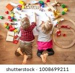 kids drawing on floor on paper. ...   Shutterstock . vector #1008699211