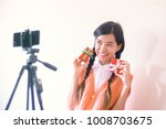 portrait of young vlogger asian ... | Shutterstock . vector #1008703675