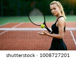woman playing tennis on court.... | Shutterstock . vector #1008727201