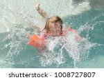 child learning to swim in a pool | Shutterstock . vector #1008727807
