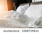 unmade rumpled bed with white... | Shutterstock . vector #1008729814