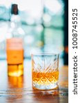 glass of scotch whiskey and... | Shutterstock . vector #1008745525