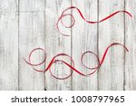 red ribbons on the white wooden ... | Shutterstock . vector #1008797965