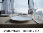 empty white plates on table at... | Shutterstock . vector #1008819415