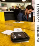 Small photo of LONDON - JANUARY 23, 2018: Vibrating technology to alert a customer that their Pizza order is ready at Mercato Metropolitano in Elephant & Castle, South London, UK.