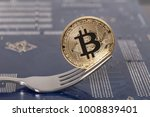 coin bitcoin on the motherboard ... | Shutterstock . vector #1008839401