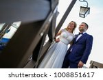 gride and groom posing on ... | Shutterstock . vector #1008851617