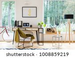 wooden lamp and stool next to a ... | Shutterstock . vector #1008859219