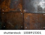 rusted metal sheets with bolts | Shutterstock . vector #1008915301