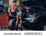 a couple in a garage. | Shutterstock . vector #1008928321