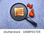toast on frying pan on grey... | Shutterstock . vector #1008931735
