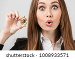 surprised young woman dressed... | Shutterstock . vector #1008933571