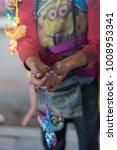 close up of mhong  boy'hands... | Shutterstock . vector #1008953341
