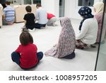 muslim family praying together... | Shutterstock . vector #1008957205