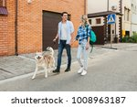 Stock photo young stylish couple walking with dog in street man and woman happy together husky breed summer 1008963187