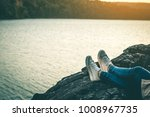 woman tourist sitting on the... | Shutterstock . vector #1008967735