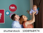beautiful mother and father... | Shutterstock . vector #1008968974