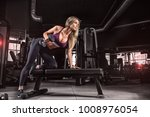 the girl in the gym crouches... | Shutterstock . vector #1008976054