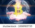hand holding bitcoin symbol.... | Shutterstock . vector #1008985735