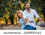 young couple enjoying a day at... | Shutterstock . vector #1008992161