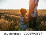 father and daughter standing in ...   Shutterstock . vector #1008993517