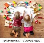 kids drawing on floor on paper. ... | Shutterstock . vector #1009017007