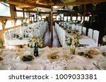 tables at the wedding banquet.... | Shutterstock . vector #1009033381